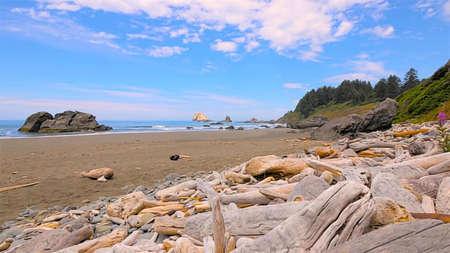 lia: Marine waves hurry ashore, struck at off-shore stone, and washing off sand at-sea.