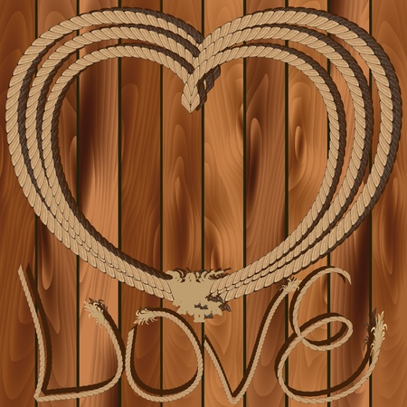 lasso: Heart of rope on a wooden background Valentines Day