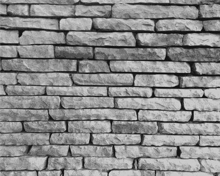 built: Stone wall in black and white close-up performed