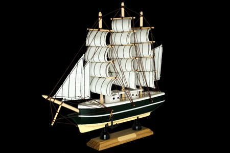 starboard: Ship Sailboat Wooden Model on a Black Background Stock Photo