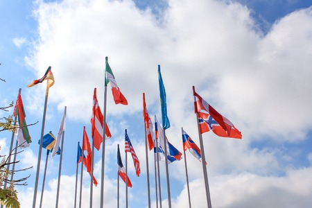 Flags of different countries on the background of the blue sky Stock Photo