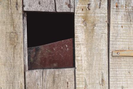 old wooden door with broken glass. piece of broken glass