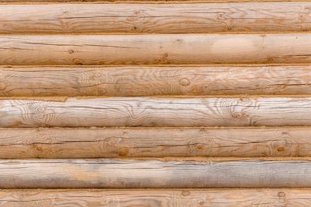 log facade with jute, natural wood, wood texture