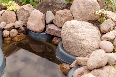 rock garden with a pond Stockfoto