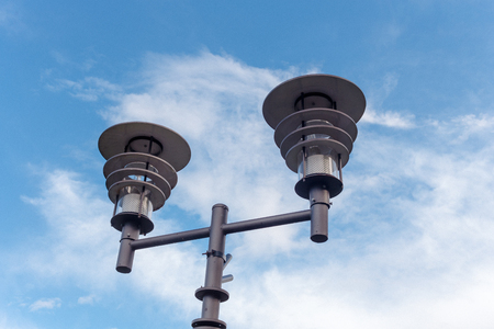 two street lights on a pole