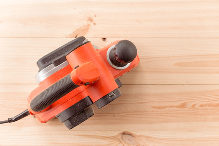 top view of the electric planer on a wooden table