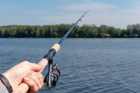mens hand holding spinning and fishing Stockfoto