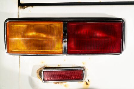 View from behind on a lantern or headlight of a car with a white body Stock Photo