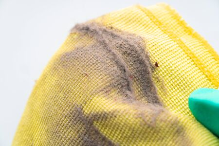 close up dust on a yellow rag after cleaning