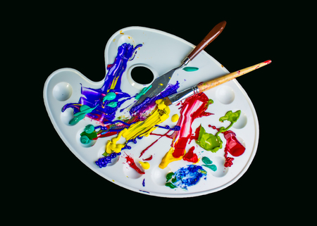 free image: Artist paint brushes and palette on black background