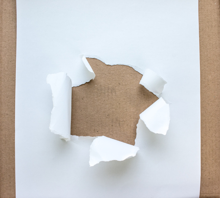 paper hole: Beige circle shape breakthrough paper hole with white background