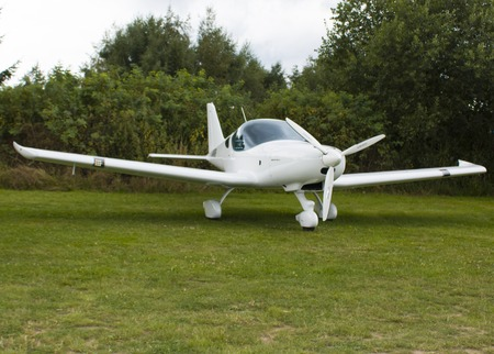 airfield: White sailplane on an airfield take off. Stock Photo