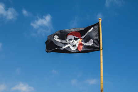 Pirate flag in the wind Stock Photo