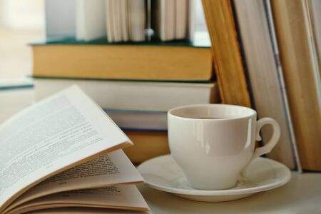 cup of tea on a background of old books Stock Photo