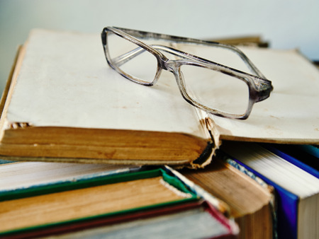 reading eye glasses on the book Stock Photo