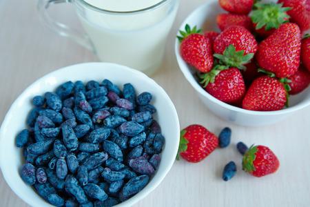 Fresh garden berries on a white wooden table Stock Photo