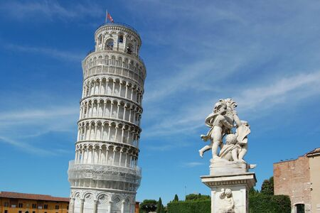 The famous leaning tower and Sculpture of angels in Pisa .  italy