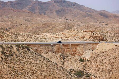 matmata: Mountain road in Matmata . Tunisia Stock Photo