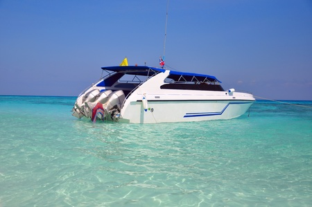 Motor boats on turquoise water of Indian Ocean, Similan Islands, Ta Chai island, Thailand