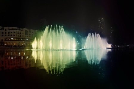 Dubai, UAE : dancing fountain on Burj Khalifa Lake. Illuminated by 6600 lights and 25 projectors, it shoots water 150 m into the air. Taken on mart 30, 2011 in Dubai.