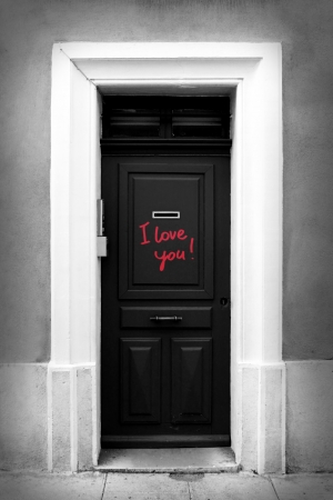 Black-and-white illustration of door with inscription I love you Stock Photo
