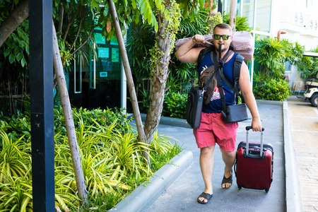 male travels with a lot of bags and luggage