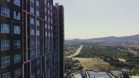 Hua Hin, Thailand - March 10, 2019: the contrast of slums and skyscrapers. Redactioneel