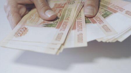 Rouble. Money. Bill 5000. Bill 2000. money. Counting money.