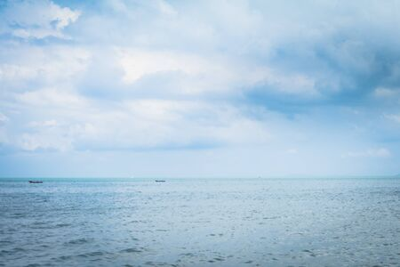 Background image of a beautiful sea horizon with clouds above it in Thailand