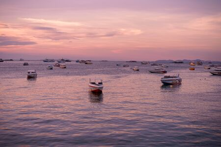 Pattaya, Thailand - April 30, 2019: Panoramic view of Pattaya city, Thailand, sunset. Landscape of tropical beach with old fishing boat Redactioneel