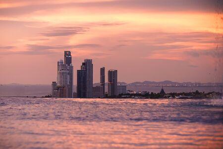 Pattaya, Thailand - April 30, 2019: Amazing pink sunrise at infinity pool, Pattaya, Thailand.