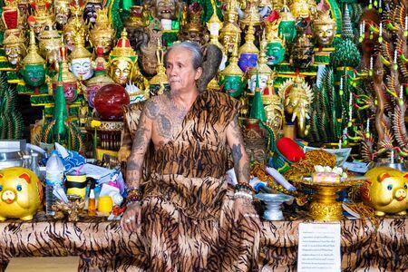 Pattaya, Thailand - May 19, 2019: Yantra tattoo or Sak Yant, Thai sacred tattoo. Master prayer tattoo Sak Yant with special oil. Thailand.