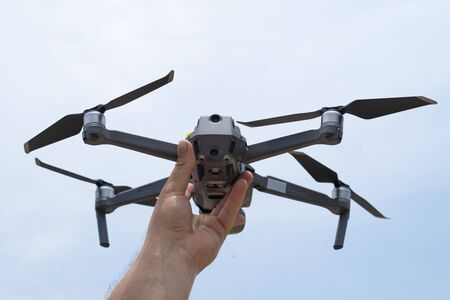 Female hand launches drone for flight, with which you can take photos and video filming, close-up.