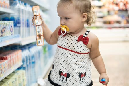 Pattaya, Thailand - May 19, 2019: The child in the store buys food. The child in the supermarket chooses food