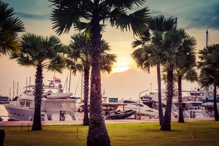 Pattaya, Thailand - May 28, 2019: Luxurious Yachts Docked At The Pier. Tropic resort at sunset Redactioneel