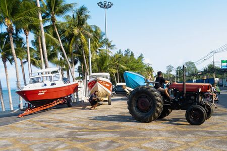 Pattaya, Thailand - May 28, 2019: Boat yard Thailand. Boats loaded onto a tractor for transportation