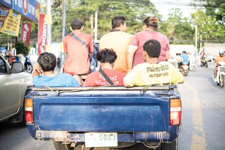 Pattaya, Thailand - May 27, 2019: Many Thais are sitting in a pickup truck, unsafe traffic