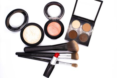 set of professional decorative cosmetics, makeup tools and accessory on white background with copy space for text. beauty, fashion, party and shopping concept. flat lay frame composition, top view.