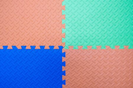 Foam flooring tiles, mats inside a play room, kindergarten school or gym. Potential use as a colourful background with copy space.