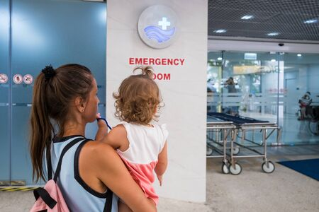 Pattaya, Thailand - May 22, 2019: Mom and child come in in the emergency room at the hospital in Pattaya Thailand