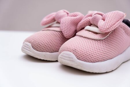 Pink baby sneakers on a white background, copy space. Stockfoto