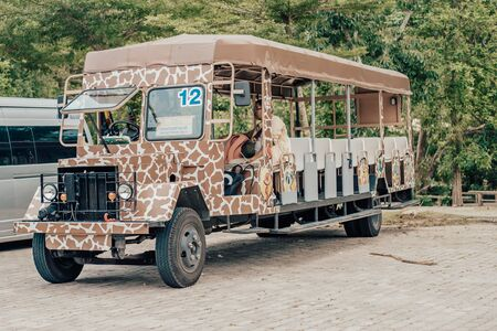 Pattaya, Thailand - May 28, 2019: Jungle safari at a zoo. Safari car in a zoo