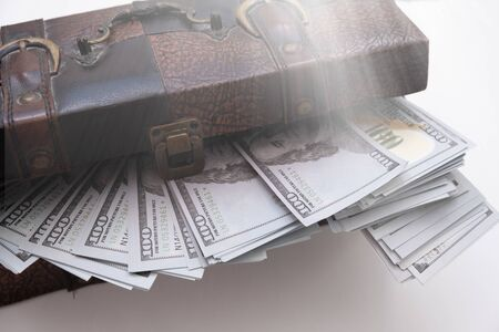 open a chest with a lot of money dollar bills lit by magic light. Concept of wealth and abundance.