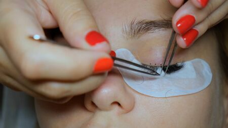 Eyelash Extension Procedure. Woman Eye with Long Eyelashes. Lashes, close up. Banco de Imagens - 132125870