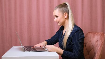 female make a purchase on the Internet using a laptop, payment by card, close-up Imagens