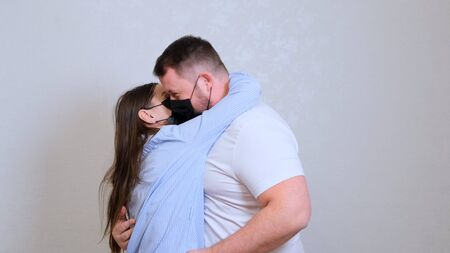 female and male kiss in protective masks. Hygiene concept. prevent the spread of germs and bacteria and avoid infection with the crown virus. Imagens - 144232702