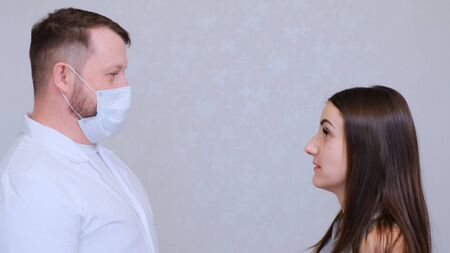 Sick woman and doctor man talking, copy space. Medicine and health concept. Diagnose the patient