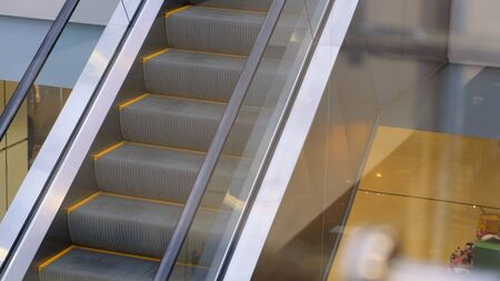 Wide Escalator That Goes Up Inside A Business Centre