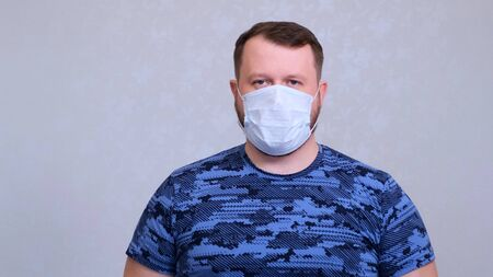 Portrait of a man wearing protective mask against coronavirus. prevent the spread of germs and bacteria and avoid infection with the crown virus.