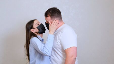 female and male kiss in protective masks. Hygiene concept. prevent the spread of germs and bacteria and avoid infection with the crown virus.